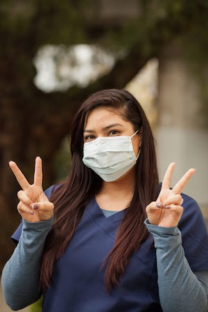 Addiction Recovery - An image of Jennifer Garcia posing with the peace sign