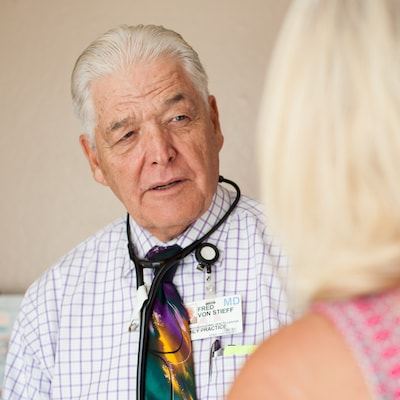 family medicine - Image of the doctor listening to find out what the patient needs